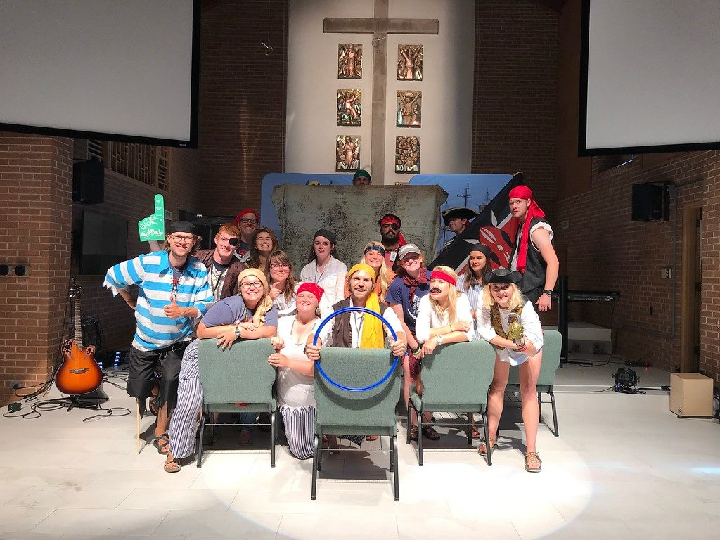 Eagle Lake Camp counselors dressed as pirates preparing to welcome campers to a church property!