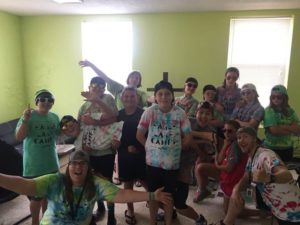 Eagle Lake Camp counselors and campers pose for picture in their new tie-dyed shirts!