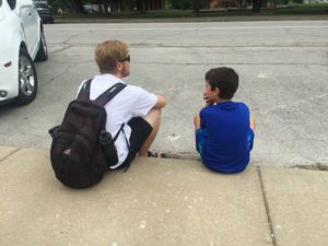 Eagle Lake Camp Counselor meets one-on-one with a camper to share about Jesus.
