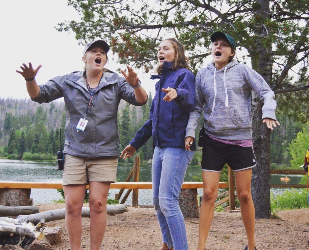 Rez Camp Leadership sings a song at Campfire