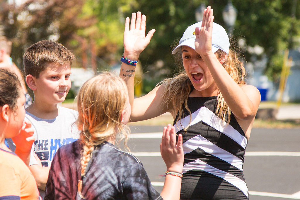 Camp Counselor High Fives a Camper during free time at Day Camp On Location!