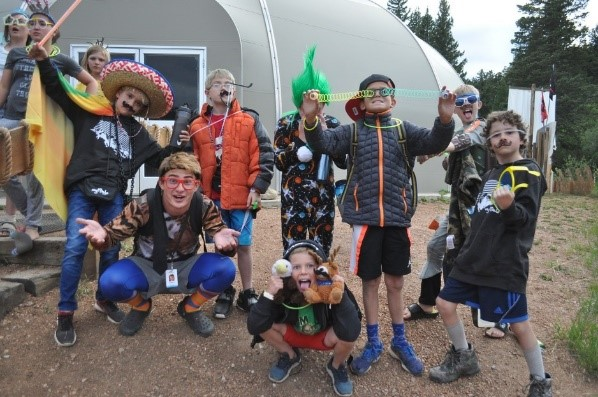 Camp Counselor and campers dress up for CRAZY night, a fun dance party.