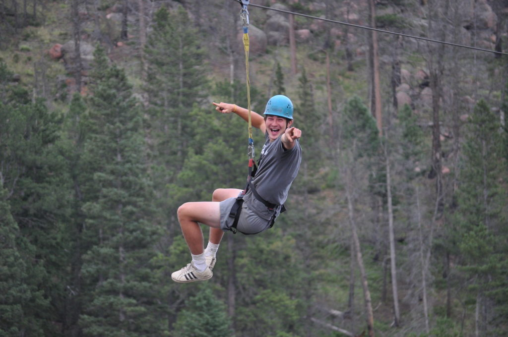 Counselor is riding the Zipline!